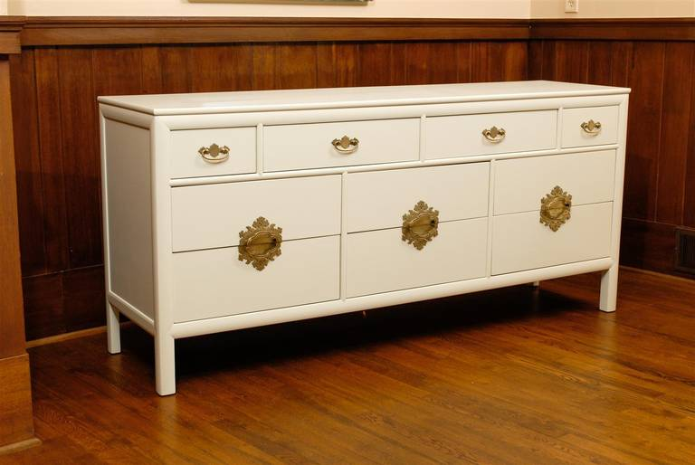 A fantastic ten-drawer chest by Century Furniture Company, circa 1970.  Expertly crafted mahogany case construction with handsome lines and detail.  The fabulous solid brass hardware is the hallmark of this particular series. This dramatic piece may