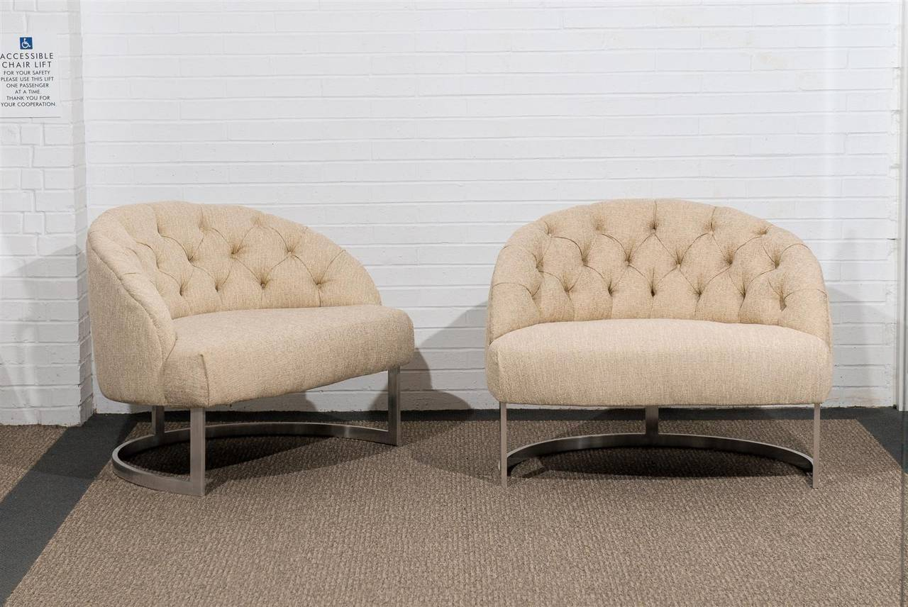 A Beautiful pair of tufted barrel back lounge or club chairs.  This Dramatic design also offers great comfort.  While the pieces are unmarked, they are reminiscent of Harvey Probber production of the 1970's.  Excellent Restored Condition, the pair