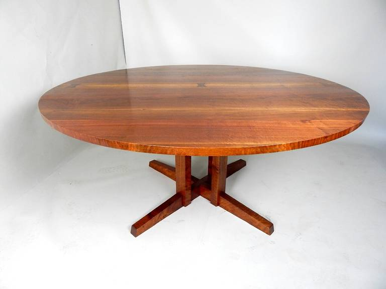 "Solid Highly figured Walnut top having Rosewood Butterfly joinery. Solid Walnut base.  This size top being 65"" in diameter is extremely rare ."