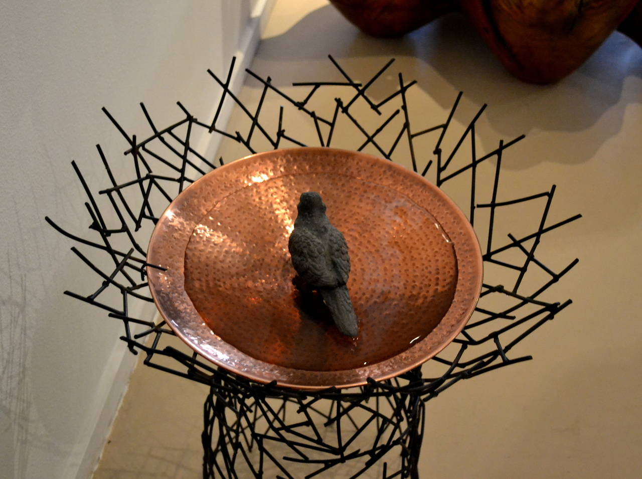 Hand-forged steel basket weave bird bath with copper bowl by artist Moira Fain. (Bird shown in bath not included).