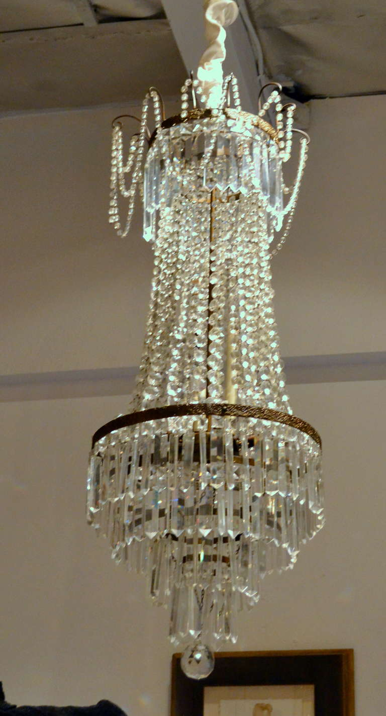 Draped in hand-cut crystals that help form the shape of this fine antique  French - Fine Antique French Empire Cut Crystal Chandelier For Sale At 1stdibs