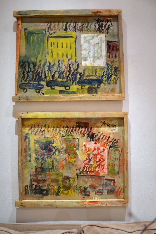 A pair of city scene paintings, one with cars, the other with trucks and both with lots of people among buildings in town.<br />