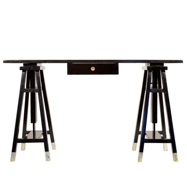 architect ebonized desk with adjustable sawhorse legs at