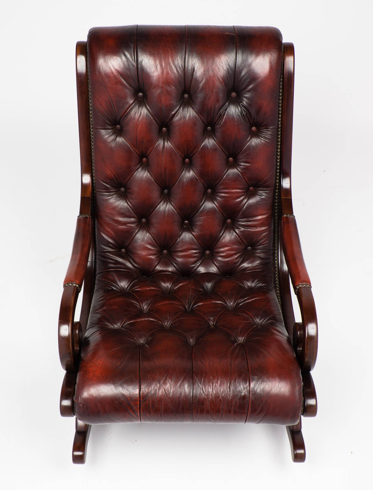 French vintage tufted leather and mahogany rocking chair at 1stdibs