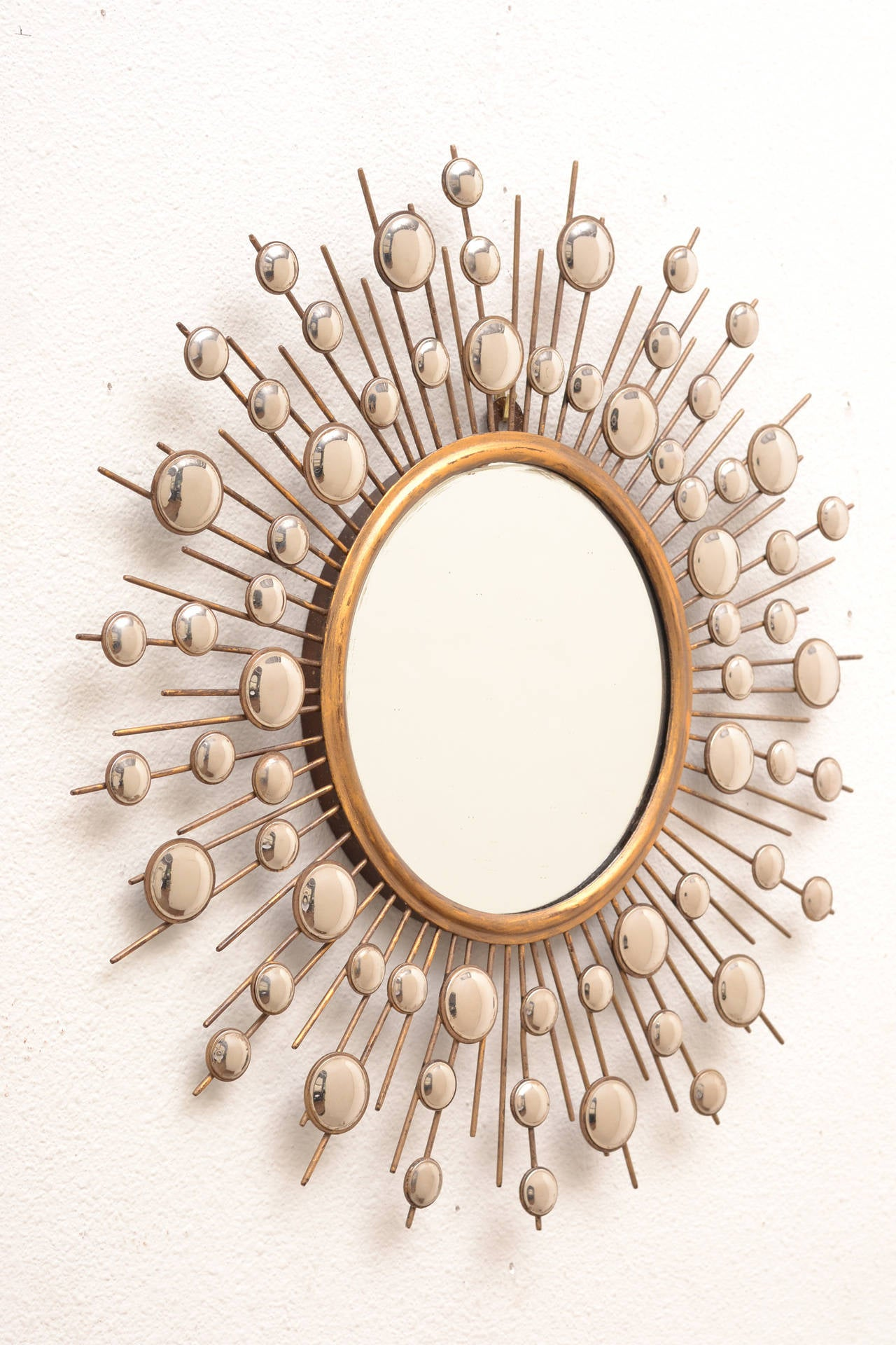 French vintage brass sunburst mirror surrounded by smaller for Sunburst mirror