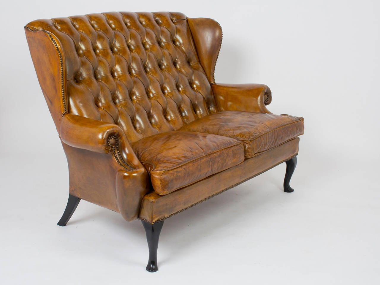 Vintage tufted leather wingback sofa at 1stdibs for Tufted leather sleeper sofa