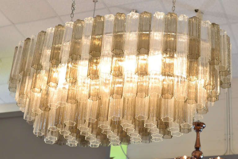 Spectacular, Mid-Century Modern style, oval-shaped chandelier. Five levels of alternating smoked and clear crystal glass