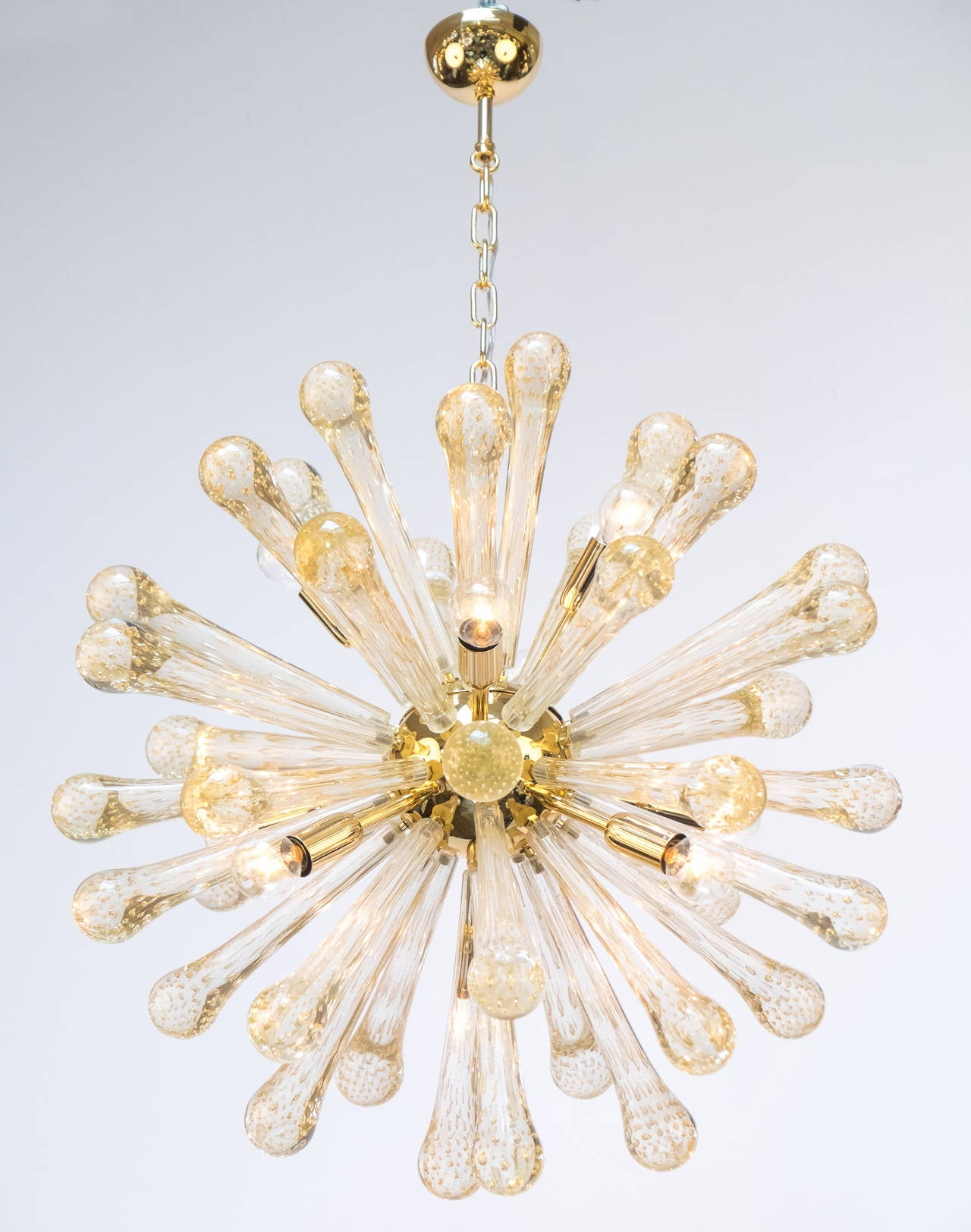 "Beautiful Murano glass and gilded brass Sputnik chandelier. An array of handblown Murano ""Pulegoso"" glass rays with 23-karat ""polvero d'oro Sommerso"" (gold leaf flecks) throughout.
