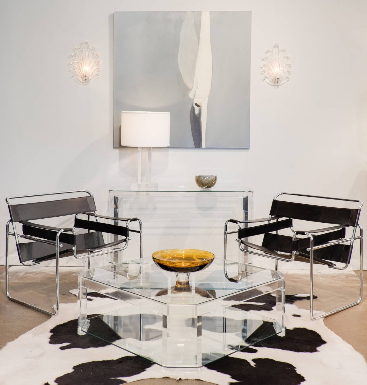 Vintage pair of Wassily chairs, designed by Marcel Breuer, with stitched black leather and a chromed steel tube frame, all in excellent condition.  Marcel Breuer was an apprentice at the Bauhaus in 1925 when he conceived the first tubular steel