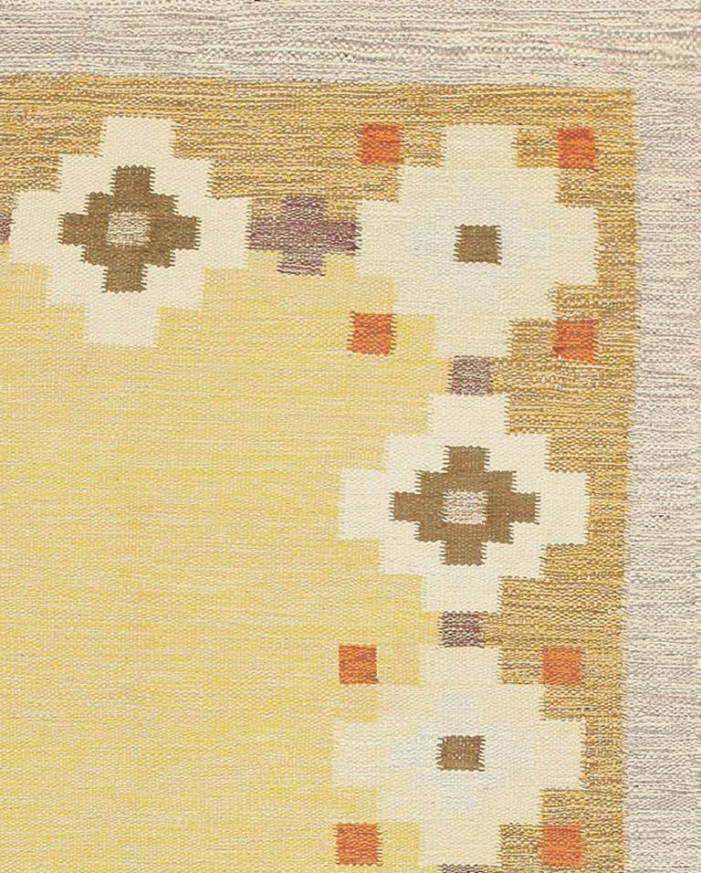 Balanced in every aspect, this vintage Scandinavian rolaken incorporates a charming assortment of flat-weave motifs and right-angle accents rendered in soft colors that capture the Mid-Century look. The border-focused design is streamlined,