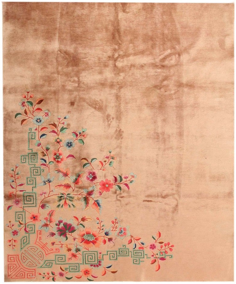 This exquisite Chinese carpet features a weighted asymmetric composition with a strong, camel-colored field off set by mint-green fretwork, an auspicious shou medallion and a detailed bouquet of colorful flowers, budding branches and bicolor leaves.