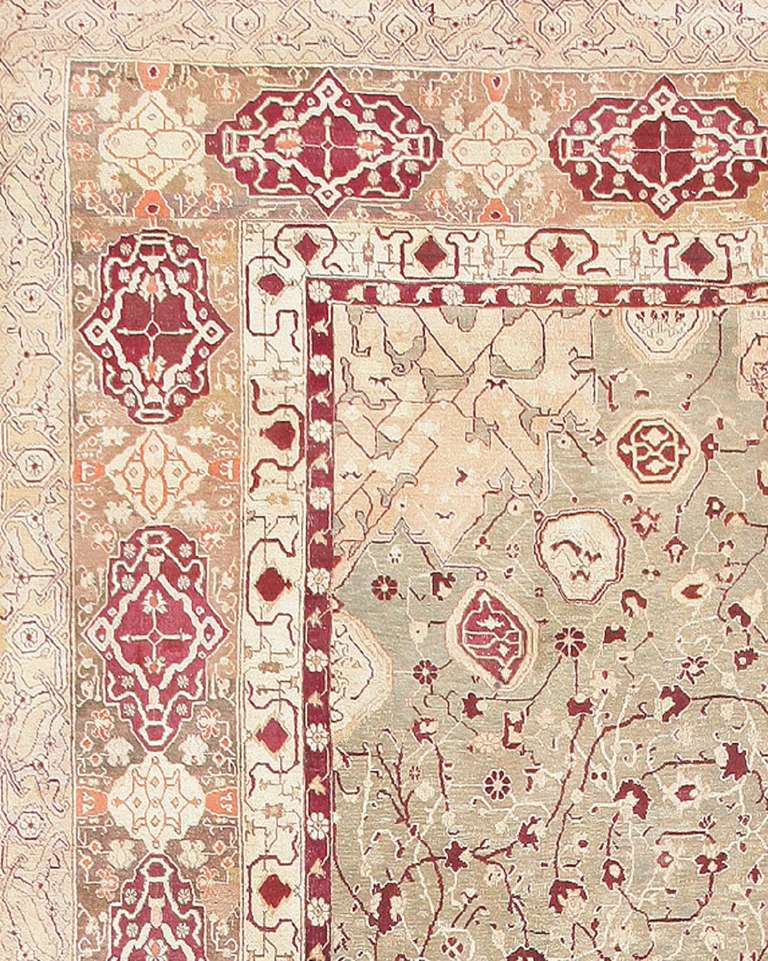 Antique Agra Rug, Country of Origin: India,  Circa Date: 1890's. Size: 10 ft x 19 ft 4 in (3.05 m x 5.89 m)  Gazing upon this rug for hours is the only way to truly see all that is incorporated into the design. A stunning red and cream crest is