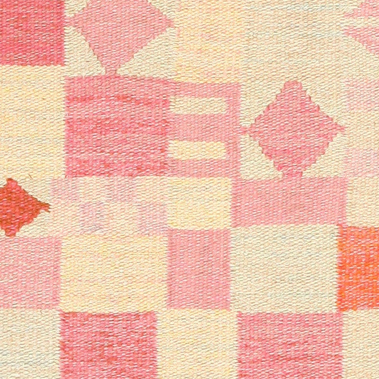 Vintage Scandinavian Swedish Kilim, circa mid-20th century, vividly toned geometric shapes define this delightful, exciting vintage Swedish rug. An abstractly woven patchwork assortment of squares, rectangles and diamonds colored in highly