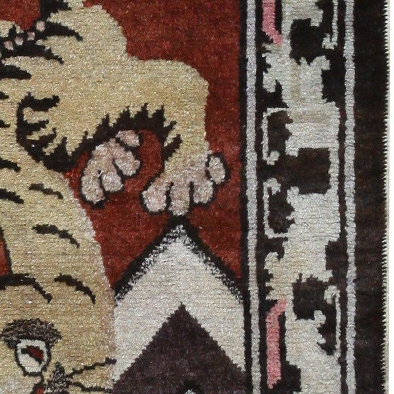 Wool Antique Tibetan Rug with Tiger Design For Sale
