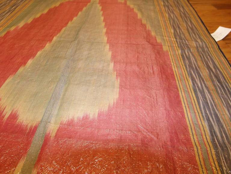 This dazzling antique Uzbek ikat is a marvelous example of this decorative, wildly popular dyeing and weaving technique, which is enjoying a modern resurgence. Using carefully dyed threads, weavers created a spectacular silk textile with a