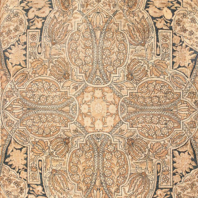 Kerman's like this are among the most elegant antique Persian carpets designed in the classical Safavid tradition of the 16th and 17th centuries. Here the field consists of a complex pattern of quatrefoil and shield-like cartouches filled with