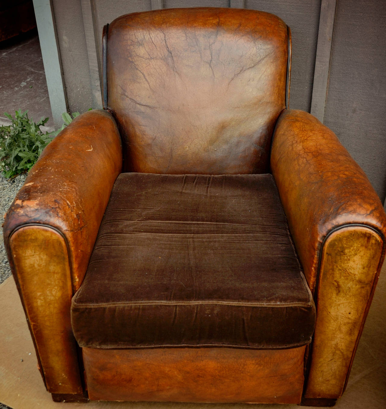 A pair of comfortable vintage French leather club chairs with velvet cushions. Approx 20th Century. Wear consistent with age and use. Priced for the set of chairs.