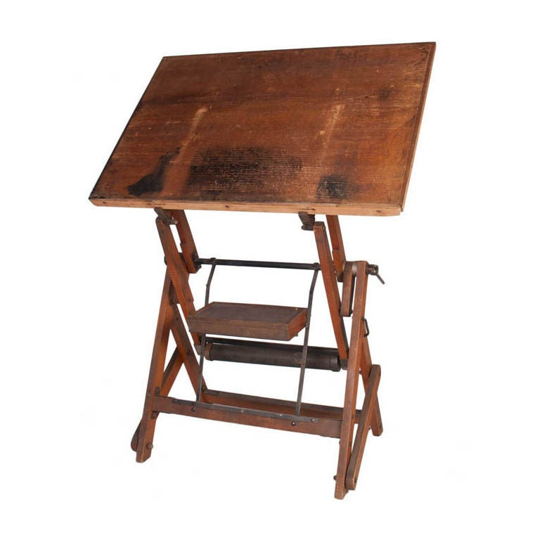 Vintage French architect desk from the 1950s. Desk has a metal counter weight with a removable pencil box. The desk is adjustable and has a wood base and top.