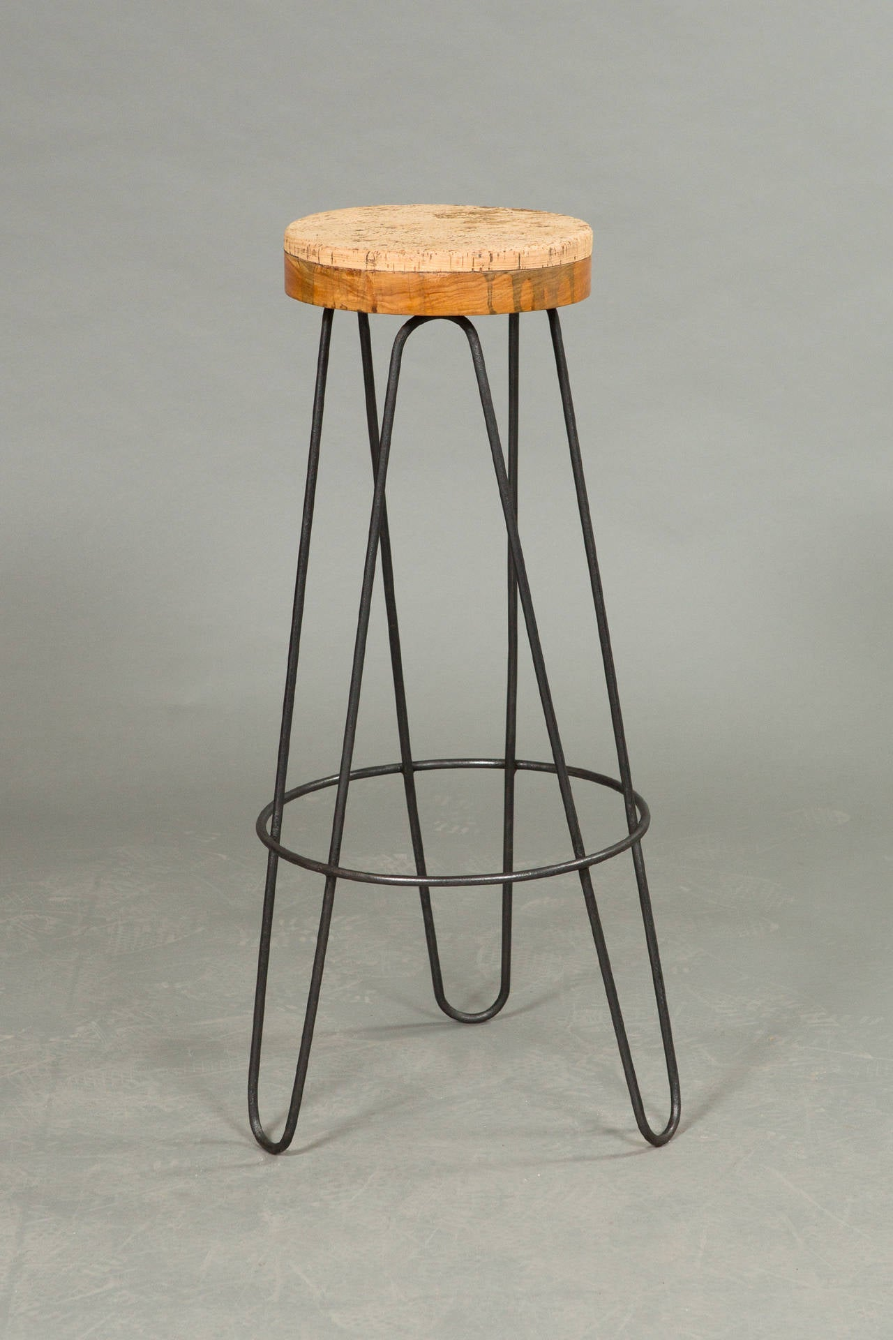 Pair of 1960s Industrial stools with hairpin style legs in the style of Florence Knoll. Iron legs and cork top mounted top.