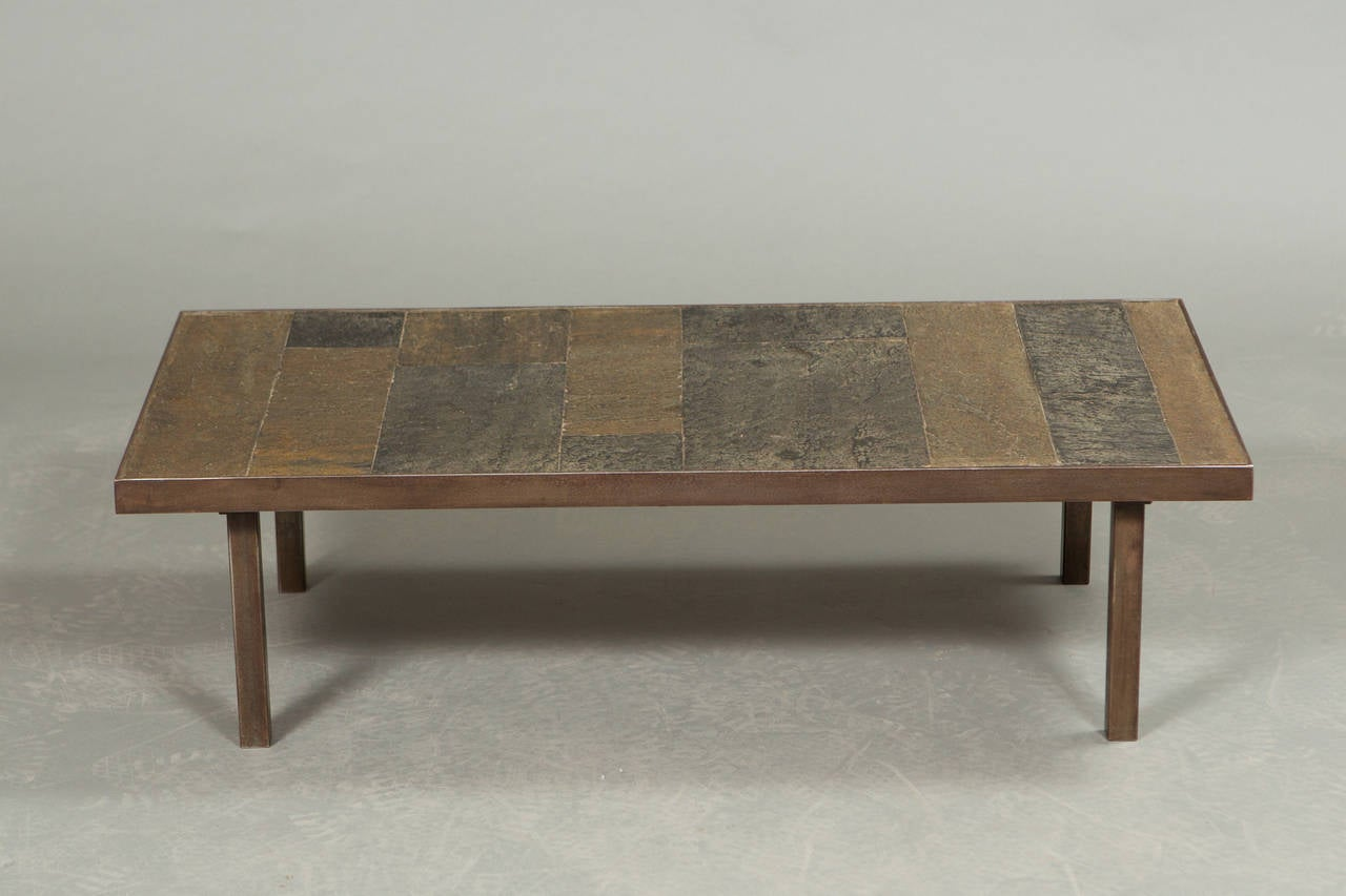 1960s coffee table in the style of Paul Kingma with hammered iron frame and slate and stone top.