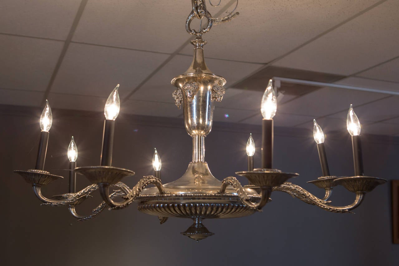 French silver plate neoclassical chandelier with applied ram's heads supporting a lower fluted bowl with eight arms. Similar style canopy included (not pictured).