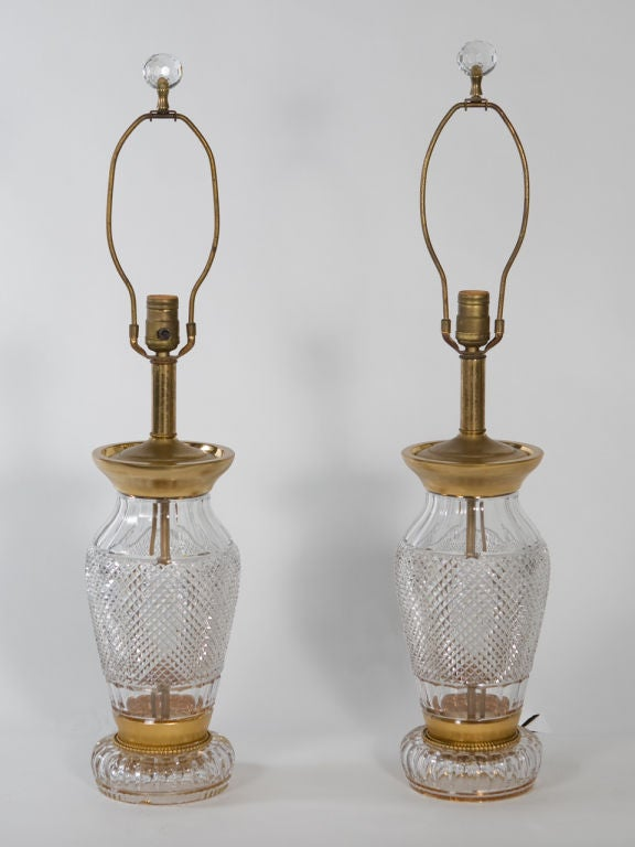 Pair of cut crystal lamps with gilt accents attributed to Waterford. Can be rewired for additional charge. Shade not included.