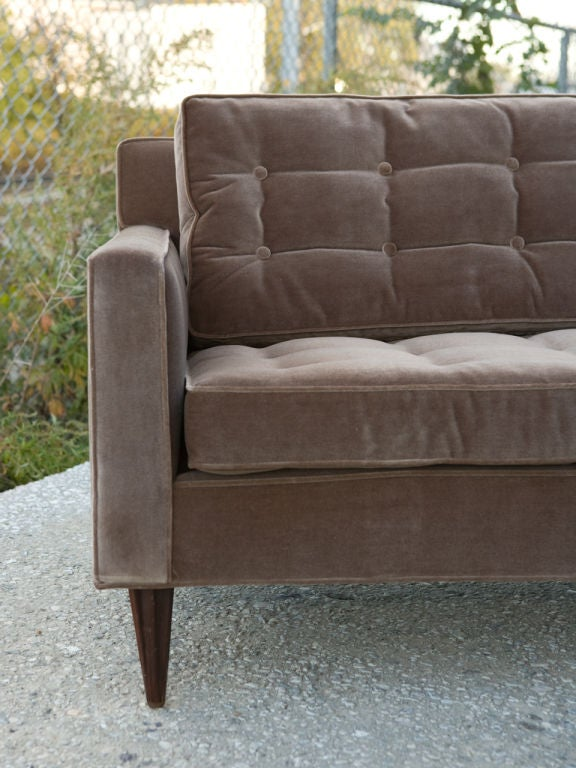 Long, elegant, Mid-Century modern button tufted sofa newly reupholstered in a mink colored Kravet fabric.<br /> Seat height - 18