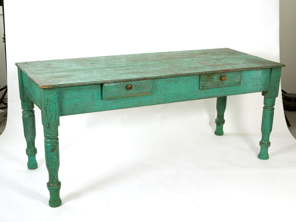 Charming rustic antique Latin American painted farmhouse table in vibrant distressed turquoise paint, with turn drawers and turned legs.