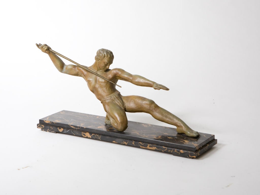 Art Deco figural bronze of a javelin thrower with patina mounted on a black marble base.
