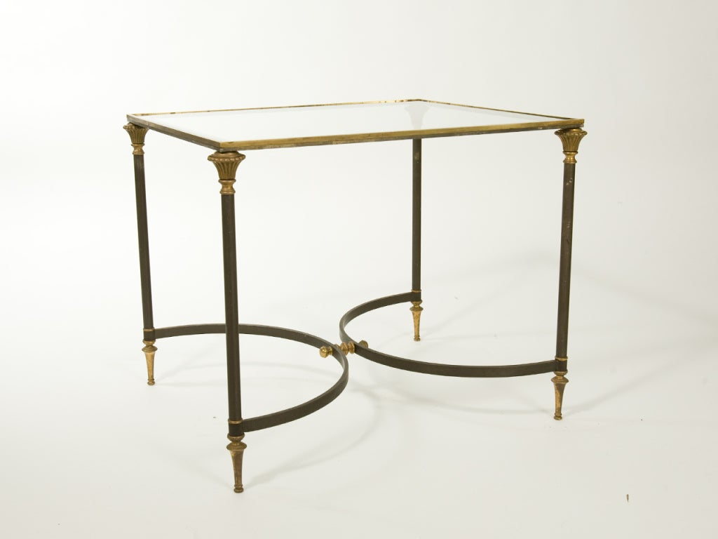 Steel and brass Neoclassical side table with glass top. Attributed to Maison Ramsay.