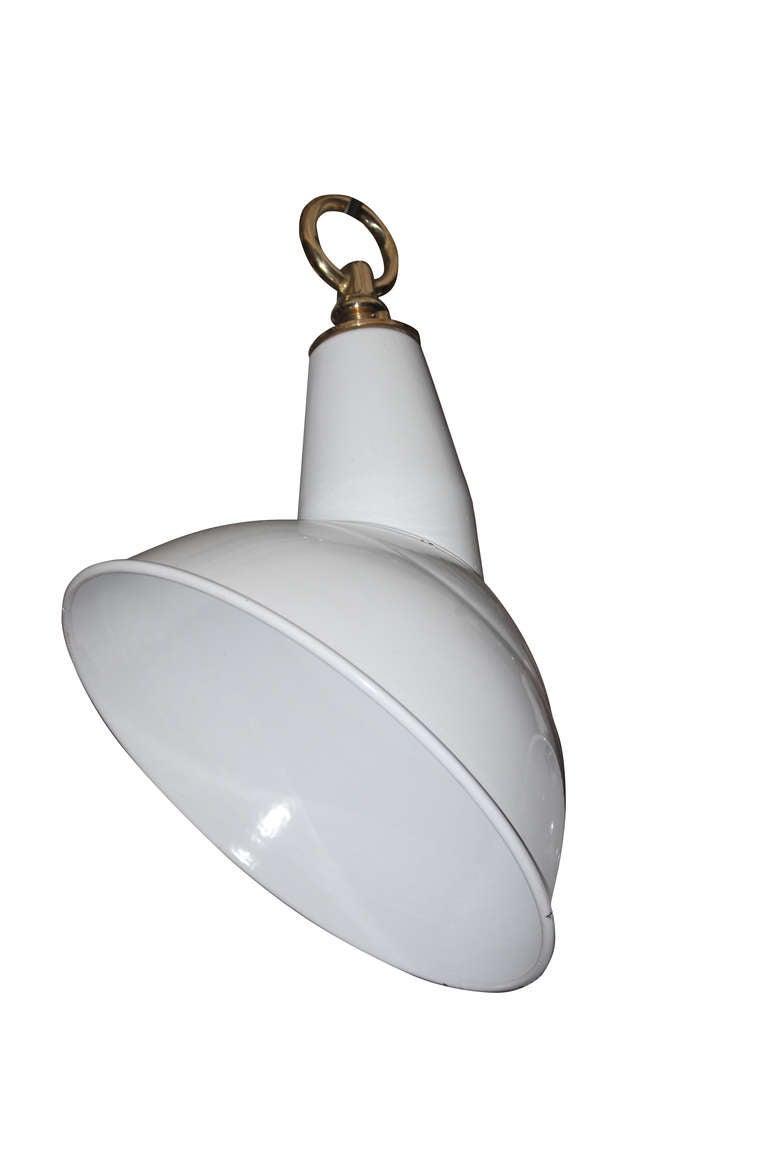 White enamel angled industrial light, UK, circa 1930.