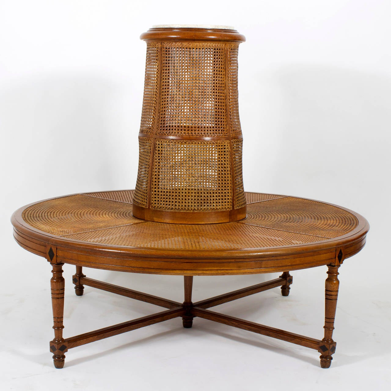 A rare and exciting, vintage round or borne settee with a distinctive tropical feel, constructed of oak, featuring well developed turned legs with diamond inlays, beaded X-stretcher, caned seat and back topped with a marble insert, to display your