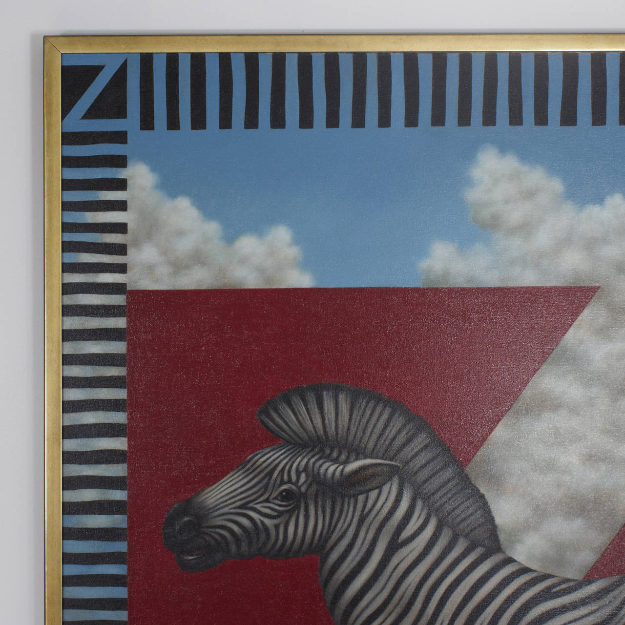 A large modern zebra painting on canvas. There are several references to the letter Z, seen in the upper corners and on the back the painting which is titled Z is 4. The shape of the clouded blue sky holds yet another reference. The red triangles