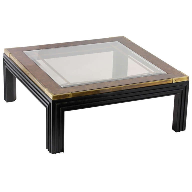 large square glass top coffee table with molded legs for
