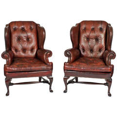 Pair of Early 20th Century Brass Tacked Tufted Leather High Back Wing Chairs