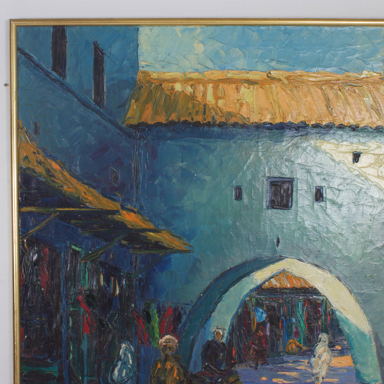 Mid Century acrylic on canvas painting of a Middle Eastern Street scene executed with bold impressionistic brush strokes. Depicting exotic Architecture with shadowy figures and colorful doorways. Signed J. Ferrer at the bottom.