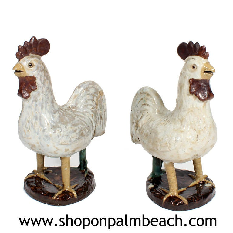 Perhaps it was the innate sense of humor of Jose Ferrer and Rosemary Clooney that inspired them to purchase this pair of French terra cotta pottery Folk Art roosters. These pottery roosters bring a smile of delight, with their heavy rounded bodies