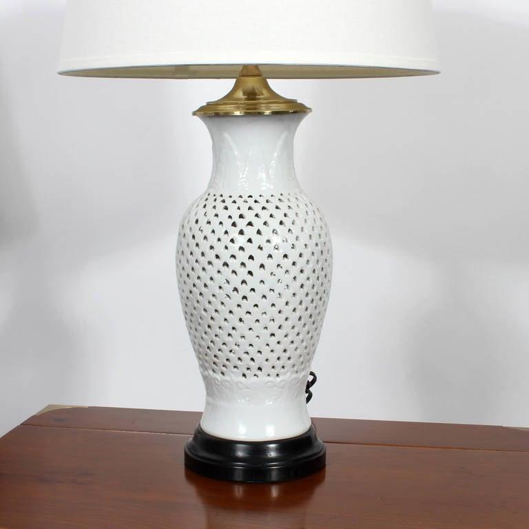 A pair of elegant blanc de chine white vase form table for Table de chine