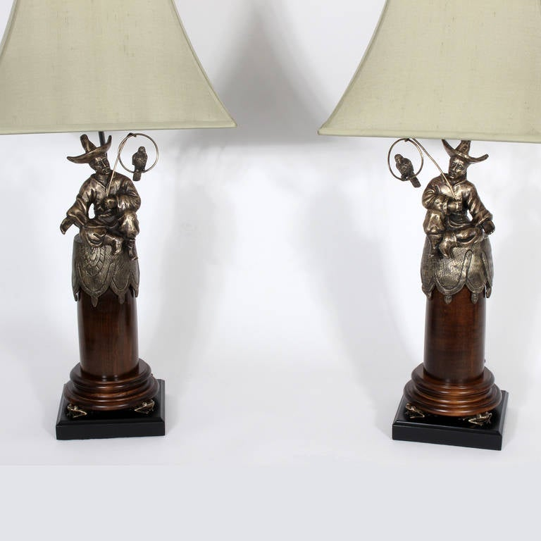pair of chinoserie style men with parrots table lamps for
