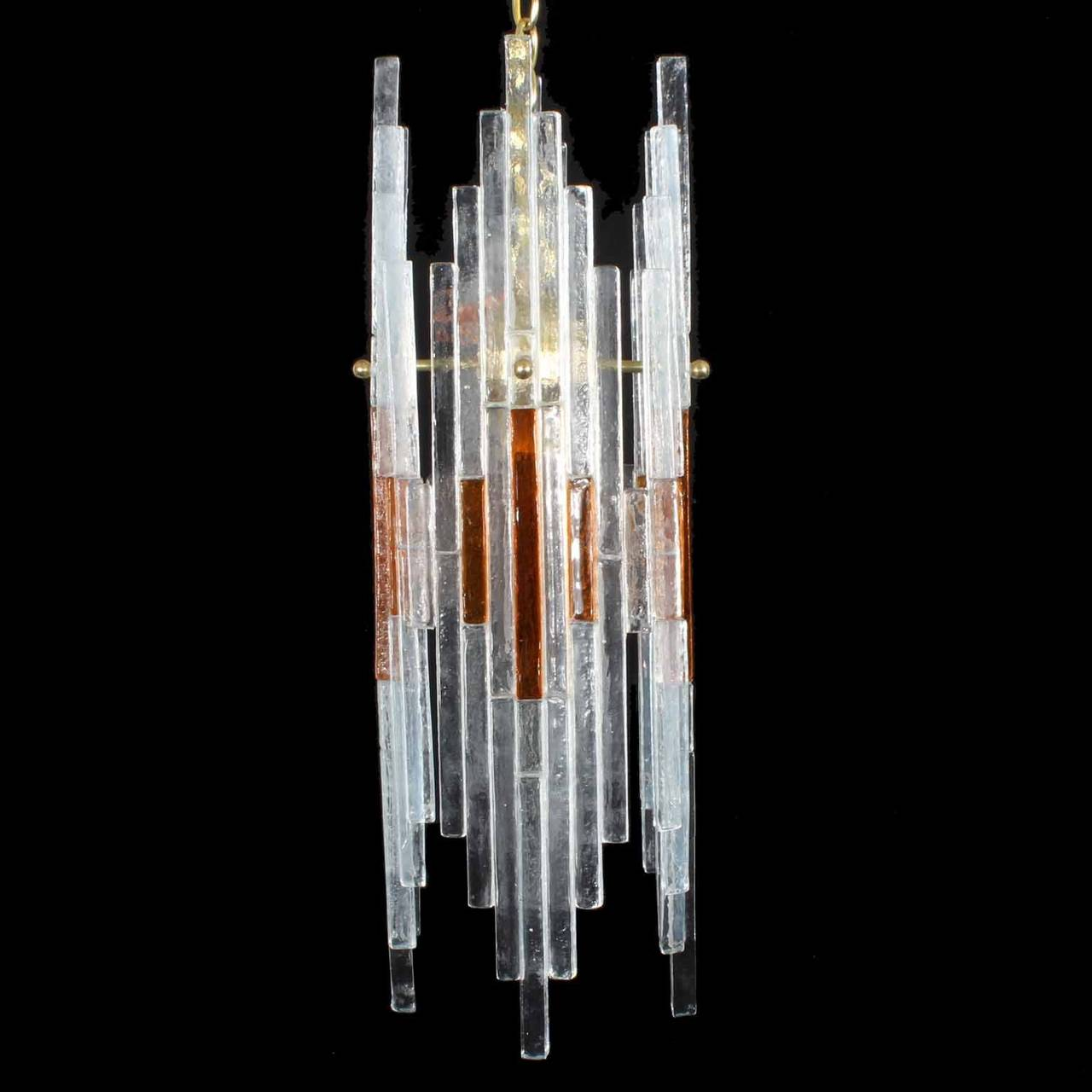 Icy cool mid century Italian light fixture with geometric art glass panels of clear and amber glass attached to a brass frame. Dramatic cubist design. Newly cleaned and wired. Accepts up to a  100 watt regular light bulb.