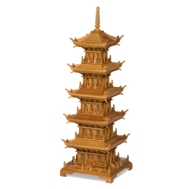 A pair of large pine pagodas, with lattice work windows, operating doors, multi-tiered tiled roofs, carved corbels and bracket bases. Pagodas are very fanciful and very hard to find in such a impressive size.