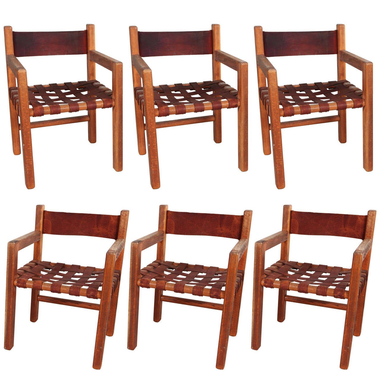 set of six wood and woven saddle leather dining chairs at
