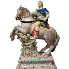An English Pearlware Pottery Equestrian Group