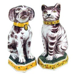 A Pair of Dutch Tin-glazed Earthenware Models of a Dog & Cat