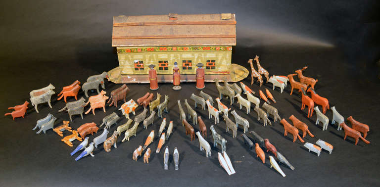 The German Wooden Noah's Ark is rom the Erzgebirge Region.  It is a magnificent hand-painted, flat-bottomed Noah's Ark complete with Noah and his wife. It comes with ninety one hand-carved and painted animals and birds including elephant, giraffes,