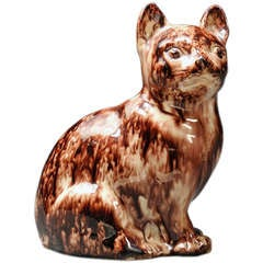 A Staffordshire Tortoise-shell Creamware Model of a Cat