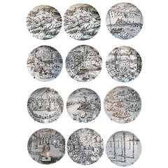 A  Set of Twelve Vintage Piero Fornasetti Plates in Citta di Carde Pattern.