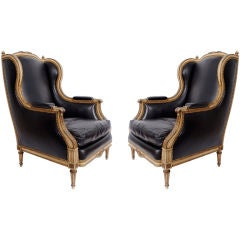Pair of leather armchairs chairs in the style of Maison Jansen