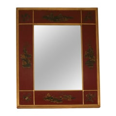 A Red Lacquered and Gilt-Decorated Panel Framed Mirror