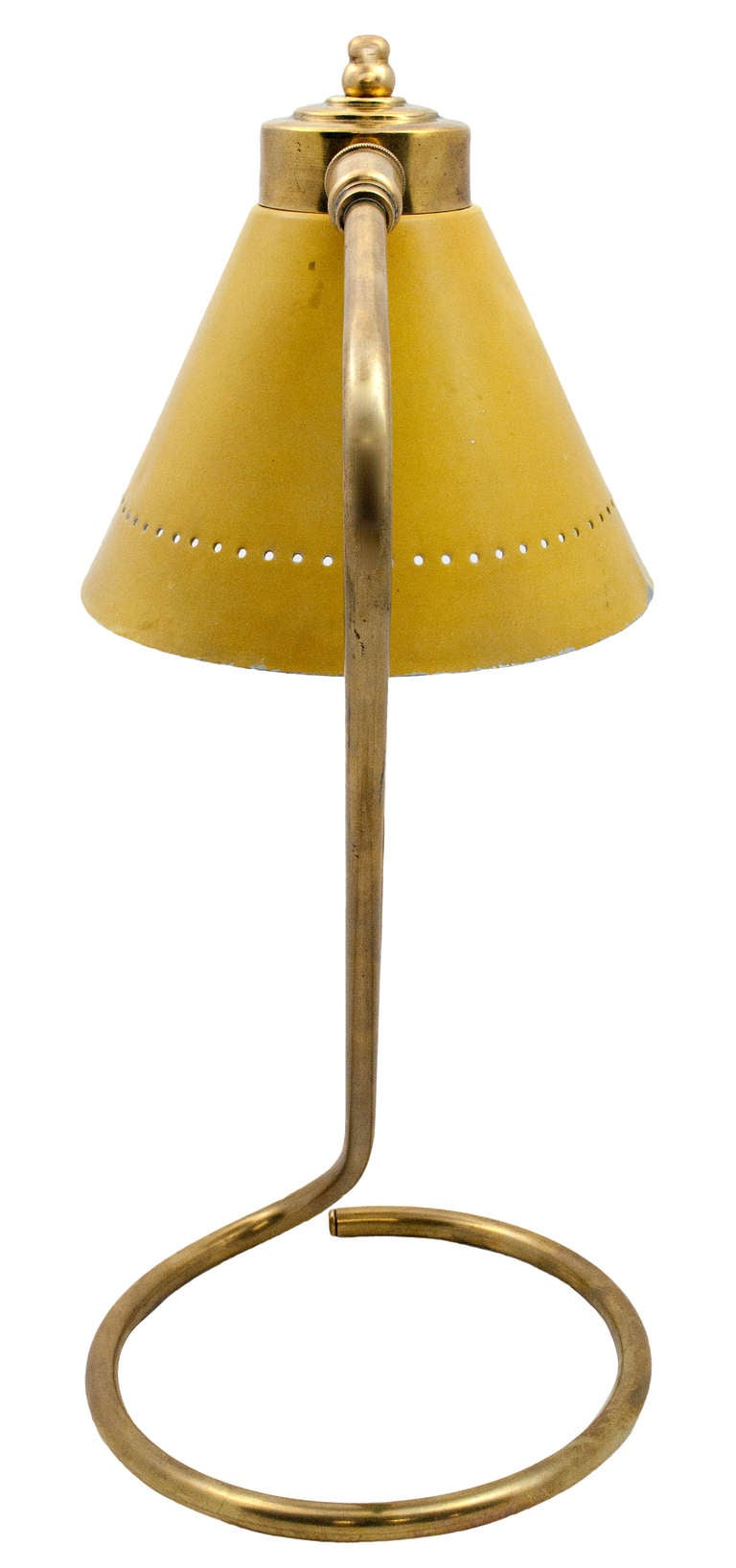 A scroll curved gilt metal desk lamp with it original yellow painted tole shade. From Branca Casa B Collection.